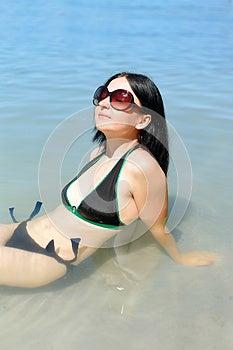 Cute Brunette Girl Sunbathes Stock Image - Image: 25877891