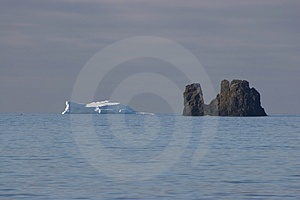 ICEBERG VS ROCK Royalty Free Stock Photography - Image: 2593687