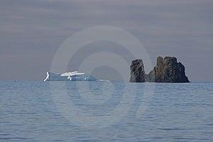 ICEBERG VS ROCK Royalty Free Stock Photography - Image: 2593687