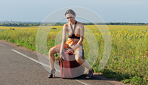 Sexy Woman In Stilettos Hitching A Ride Stock Image - Image: 25911621