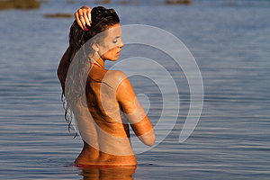 Girl Bathing In Water At Dawn Stock Photography - Image: 25945602