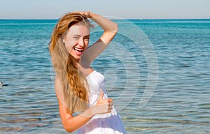 Smiling Woman At The Beach Royalty Free Stock Image - Image: 25948836