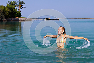 Happy Young Woman Playing In The Sea Royalty Free Stock Images - Image: 25970319