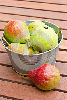 Fresh Colourful Pears In Bowl On Wooden Backgro Stock Image - Image: 25972721