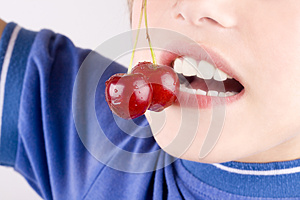 Cherry In The Mouth Stock Image - Image: 25973611
