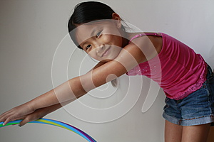 Little Asian Girl With Hula Hoop Stock Photos - Image: 25980203