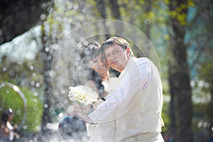 Happy Bride And Groom With Bouquet Royalty Free Stock Image - Image: 25980796