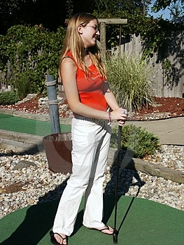 Girl With Putter Stock Images