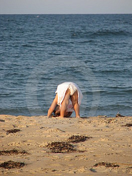 Little Girl Stretching Her Backside Free Stock Photo
