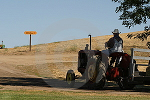 Farmer And His Tractor Stock Photography