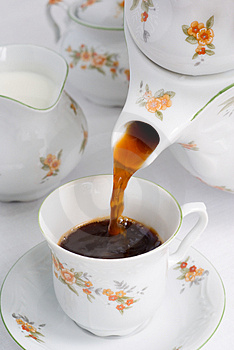 Pouring coffee or tea. Free Stock Image