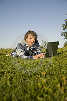 Man Using A Laptop Outdoors Stock Image - Image: 2607771