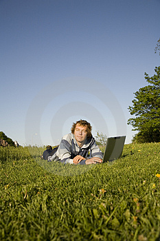 Man Using A Laptop Outdoors Royalty Free Stock Photography - Image: 2607807