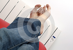 Warming Feet Against The Radiator Royalty Free Stock Images - Image: 26113629