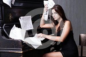 Sad Girl Near Piano Royalty Free Stock Image - Image: 26116906
