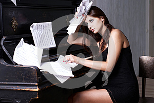 Sad Girl Near Piano Royalty Free Stock Image - Image: 26116926
