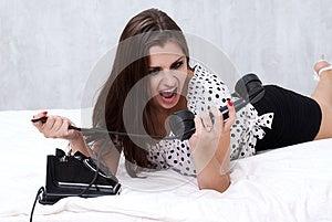 Brunette Talking On The Retro Phone Royalty Free Stock Image - Image: 26117546