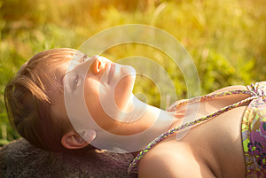 Young Woman Lying On The Stone Stock Images - Image: 26161674