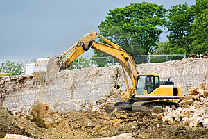 Backhoe Dumping Dirt Stock Image - Image: 2625661