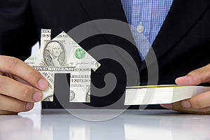 Hand Holding Banknote House Icon Stock Photo - Image: 26202550