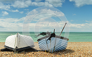 Two Boats On The Beach One Upside-down Royalty Free Stock Images - Image: 26264589