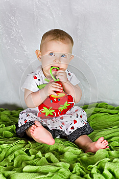 Baby Girl And The Strawberry's Dress Royalty Free Stock Photography - Image: 26283917