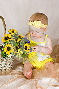 Baby Looking At Flowers Stock Images - Image: 26283934