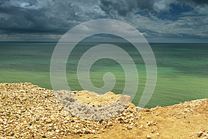 Seaside With Cliff Edge - Green Water Royalty Free Stock Image - Image: 26284566
