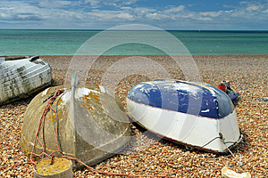 Three Boats On The Beach Upside-down Royalty Free Stock Photo - Image: 26284585