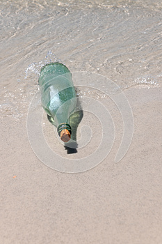 Message In A Bottle On Sand Royalty Free Stock Photos - Image: 26335538