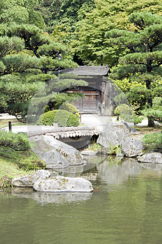 Japanese Garden With A Traditional Gate Royalty Free Stock Photos - Image: 26345468
