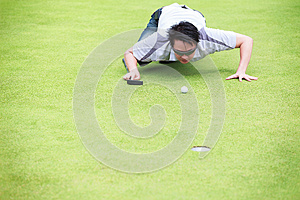 Golfer Checking Line Of Putt Royalty Free Stock Photo - Image: 26350685