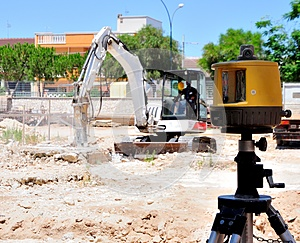 Excavator With Hammer Demolishes E Laser Stock Image - Image: 26400301