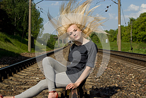 Girl Blonde Sitting On The Rails Royalty Free Stock Photography - Image: 26414157