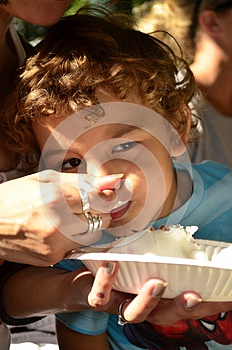 A Young Boy Eating A Cake Stock Images - Image: 26422854