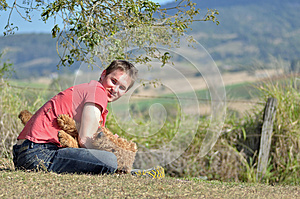 Young Man Playing With Dog In Countryside Stock Image - Image: 26478691