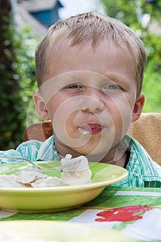 Boy Eats Breakfast Outdoors Stock Image - Image: 26563361