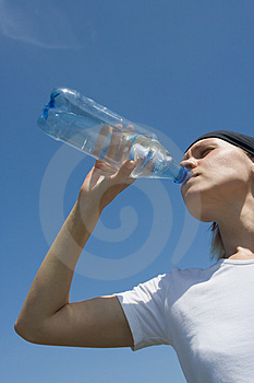 Sporty woman have water Royalty Free Stock Photography
