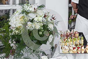 Flowers Bouquet And Tray Canapes Royalty Free Stock Photo - Image: 26615015