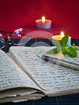 An Open Old Book By The Candlelight Royalty Free Stock Photography - Image: 26621957
