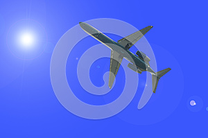 Airplane Over The Sun Flare Royalty Free Stock Photo - Image: 26627675