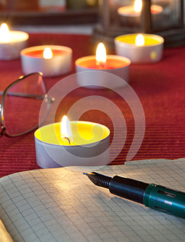 An Open Old Book By The Candlelight, Stock Image - Image: 26652891