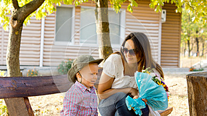 Little Boy Giving Mum A Bouquet Of Flowers Royalty Free Stock Image - Image: 26718706