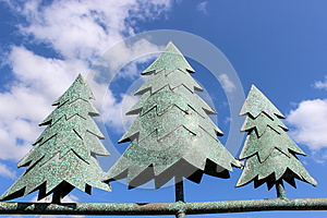 Metal Pine Trees Against Bright Blue Sky Stock Images - Image: 26778774