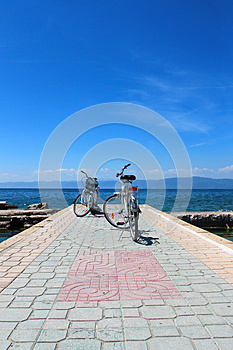 Two White Bicycles With The Lake In The Background Stock Images - Image: 26794134