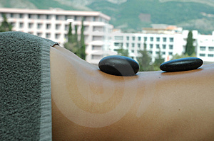 Hot stones massage Stock Image
