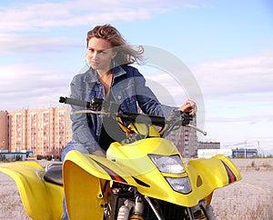 Dyakova Helen On Quadrocycle. Stock Images - Image: 26815764