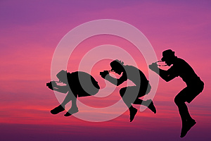 Silhouette Photographer Jumped In The Sky. Stock Images - Image: 26841924