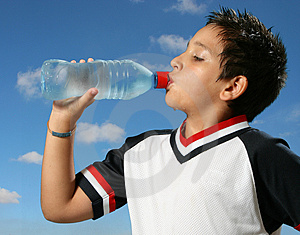 Thirsty boy drinking water out Free Stock Photo
