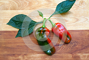 Two Peppers On Cutting Board Royalty Free Stock Photos - Image: 27033258